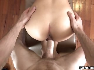 Slutty brunette with shaved pussy rides cock