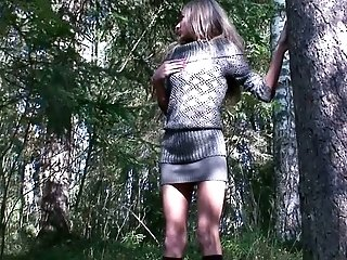 Long legged skinn Russian teen in the woods pisses under the tree