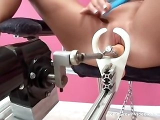 Tight brunette fucked by a sex machine