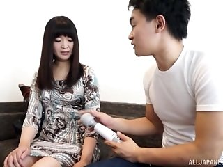 Brunette Japanese gets her pussy pleased by a white vibrator