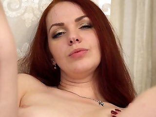 Long haired ginger beauty Alice Wonderland takes various poses during fingerfuck