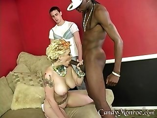 Gorgeous Candy Monroe gets fucked by strong dick on the bed while she moans