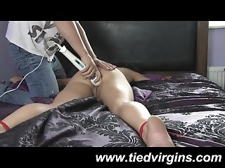 Kinky teen The Masked Slut has her arms and legs tied to the bed