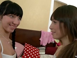 Margarita and Natalia enjoy a lesbian game with a massive dildo