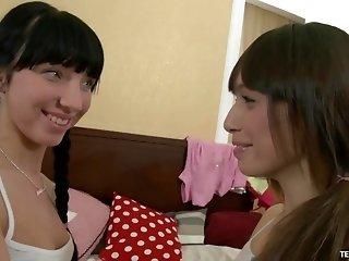 Margarita and Natalia enjoy a lesbian game with a massive dildo