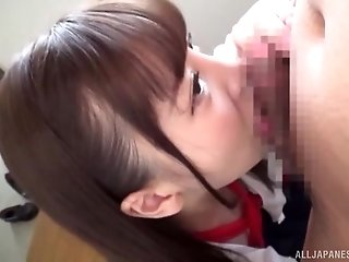 Costumed long haired Japanese Sazanami Aya blows cock on her knees