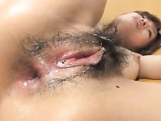 Japanese slut with hairy pussy is crying while two guys are reaming her ass