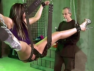 Teen brunette submissive slut hanged on a swing and pussy abused hard